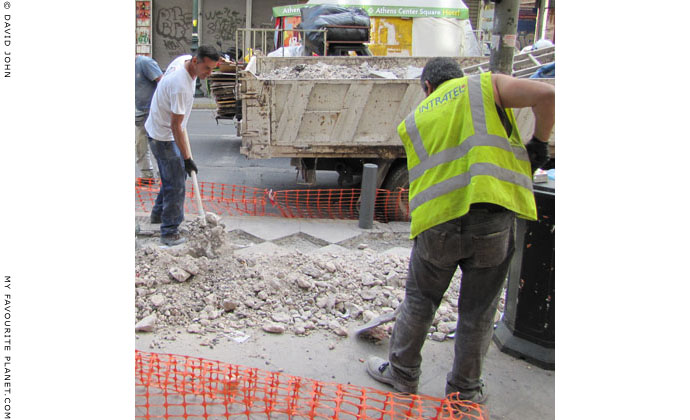 Athenian workers repairing Athinas Street, Athens at The Cheshire Cat Blog
