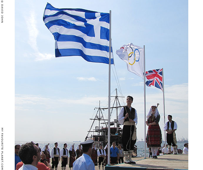 The British, Greek and Olympic flags flying during the 2012 Olympic flame ceremony in Thessaloniki, Greece, at The Cheshire Cat Blog