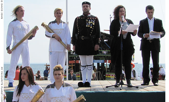 A speech being given during the 2012 Olympic flame ceremony in Thessaloniki, Greece at The Cheshire Cat Blog