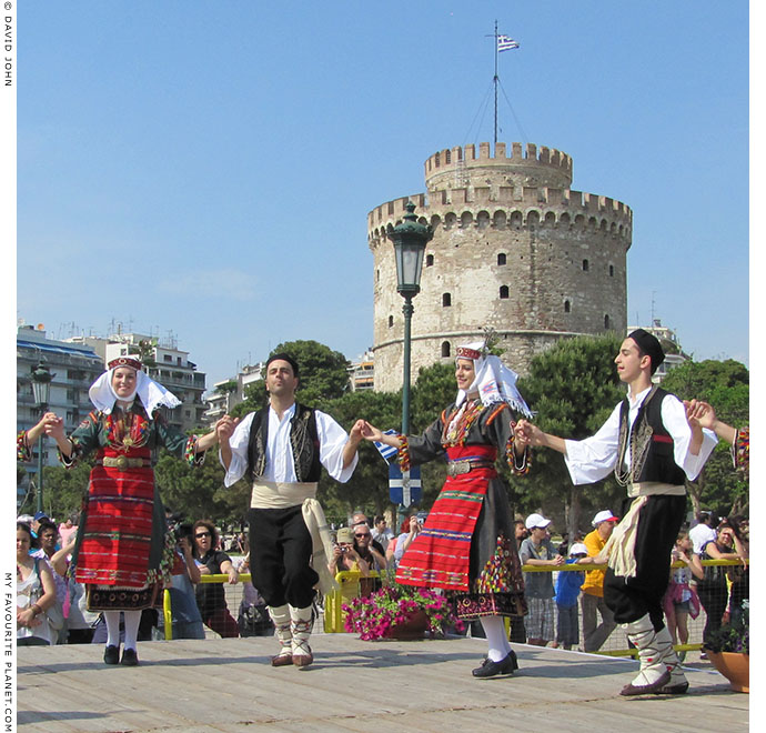 Young Macedonians dancing in traditional Greek costumes in Thessaloniki, Greece, at The Cheshire Cat Blog