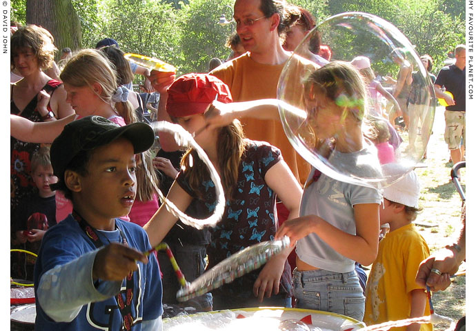 Blowing bubbles at Weltfest am Boxi, by The Cheshire Cat Blog