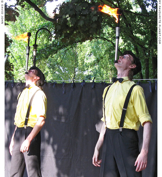 Duo Goidon juggle fire at The Cheshire Cat Blog