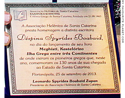 The honour plaque presented to Despina Spyrídes Boabaid during the book launch at The Cheshire Cat Blog