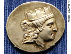 Coin from Smyrna showing the goddess Tyche wearing a mural crown