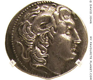 A silver tetradrachm coin depicting Alexander the Great wearing the ram's horns of Zeus Ammon at My Favourite Planet