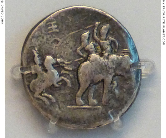 Silver decadrachm coin showing Alexander the Great fighting king Poros of Paurava on an elephant at My Favourite Planet