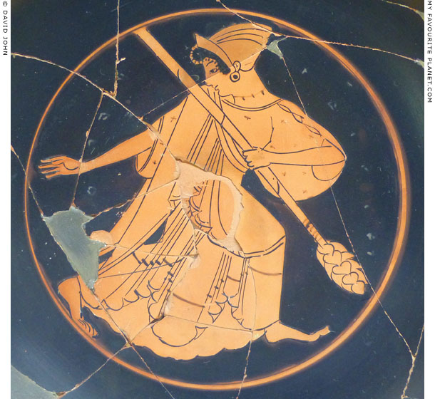 Detail of an Attic kylix depicting a Maenad holding a thyrsos at My Favourite Planet