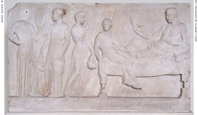 Votive relief showing Dionysus with actors, from Piraeus at My Favourite Planet