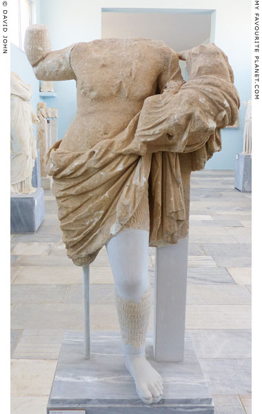 Statue of a Papposilenos actor holding the infant Dionysus at My Favourite Planet