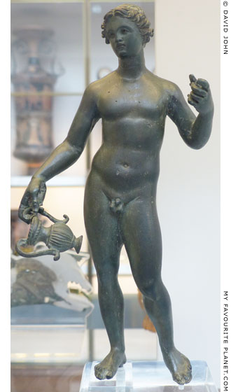 Bronze statuette of Dionysos holding a kantharos at My Favourite Planet