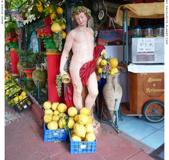 A modern plaster statue of Bacchus in Pompeii at My Favourite Planet