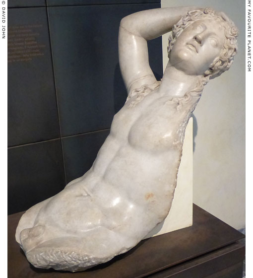 A fragment of a marble statue of Dionysus reclining at My Favourite Planet