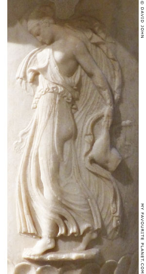Detail of the Marble fountain with a relief of a dancing Maenad at My Favourite Planet