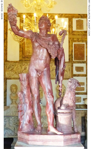 A statue of a Faun in marmo rosso antico at My Favourite Planet