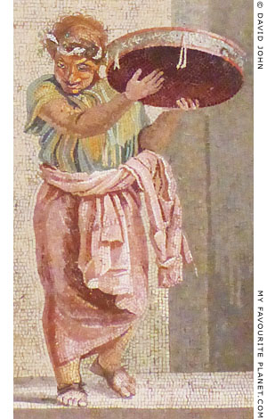 A street musician playing a tympanon in a mosaic by Dioskourides of Samos at My Favourite Planet